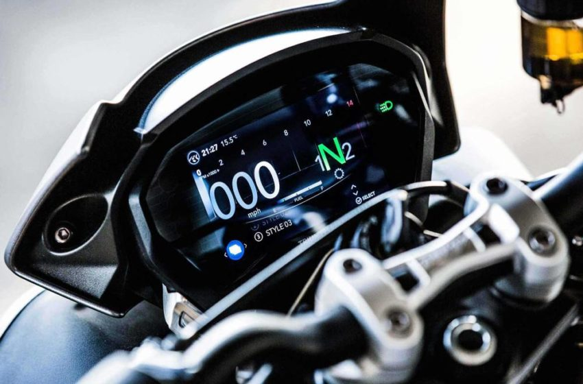 How motorcycle system achieves traction?